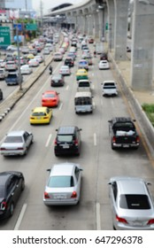 Aerial blurred image of traffic along in Bangkok,Thailand. High-occupancy vehicle lane used at peak travel times. Urban infrastructure problem.
