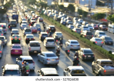 Aerial blurred image of traffic  in Bangkok, Thailand. High-occupancy vehicle lane used at peak travel times. Urban infrastructure problem.