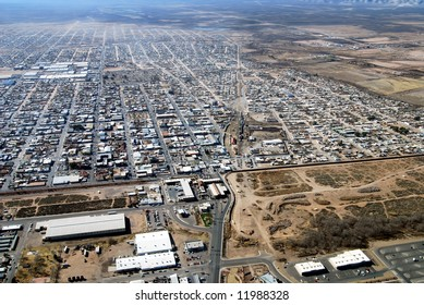 Aerial of border crossing and town of Agua Prieta, with Douglas, Arizona, below on the U.S. side of the border fence.