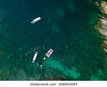 Aerial of cabin cruiser on the big ocean in Andaman take tourist goto snorkeling point at koh mai thon, Phuket, Thailand