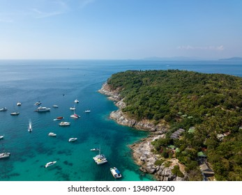 Aerial of cabin cruiser and yacht on the big ocean in Andaman take tourist goto snorkeling point at koh racha yai, Phuket, Thailand