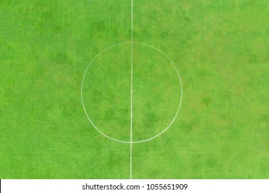 Aerial at the center of the green football field from drone
