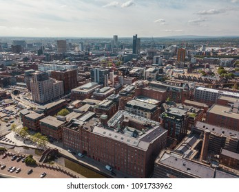Aerial city centre drone above buildings british manchester skyline summer blue sky ancoats northern quarter
