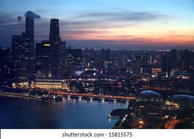 Aerial city skyline of Singapore during sunset at Marina Bay.