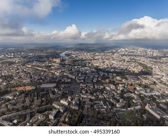 Aerial city view with crossroads and roads, buildings, houses, parks and parking lots, bridges. Panoramic image of Krakow, Poland