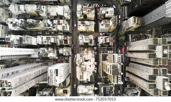 Aerial city view with crossroads and roads, houses, buildings and parking lots. Helicopter drone shot. Wide Panoramic image.