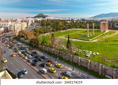 Aerial city view with Ruins and a columns of the Temple of Olympian Zeus, Mount Lycabettus in the background, Athens, Greece