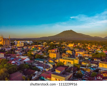 Aerial city view of San Pablo City, Laguna's plaza during sunset