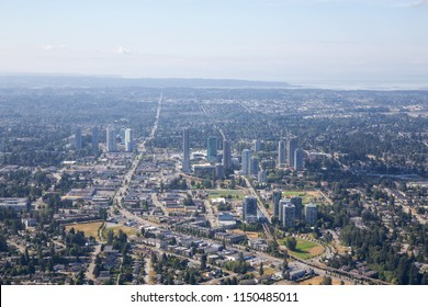 Aerial city view of Surrey Central during a sunny summer day. Taken in Greater Vancouver, British Columbia, Canada.