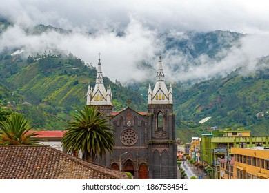 Aerial cityscape of Banos de Agua Santa located in the cloud forest with the bell towers of the Holy Water Virgin Church, Ecuador.