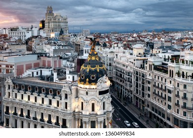 Aerial cityscape of Madrid with the famous Metropolis building at sunset in Madrid, Spain