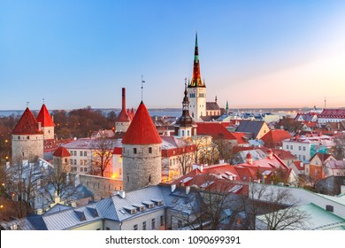 Aerial cityscape with Medieval Old Town, St. Olaf Baptist Church and Tallinn City Wall in the morning, Tallinn, Estonia