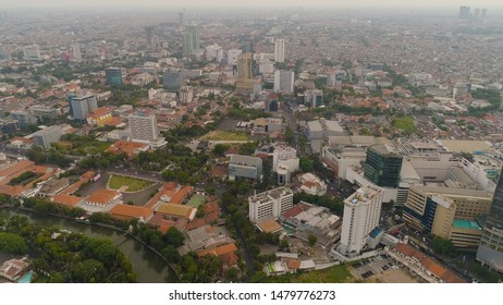 Aerial cityscape modern city Surabaya with skyscrapers, buildings and houses. sunset in city skyline with skyscrapers and business centers Surabaya capital city east java, indonesia