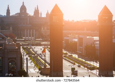 Aerial cityscape on Placa Espanya(Spain square) and Montjuic Hill with National Art Museum of Catalonia in the backlight morning sunbeam light. Barcelona, Spain.