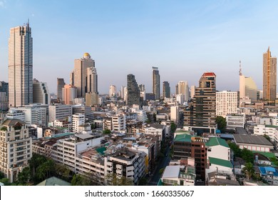 Aerial cityscape of picturesque Bangkok at daytime from rooftop. Panoramic skyline of the biggest city in Thailand. The concept of metropolis.