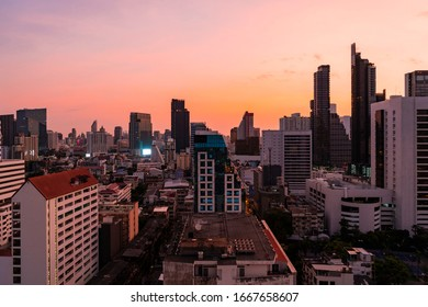 Aerial cityscape of picturesque Bangkok at sunset from rooftop view. Panoramic sunrise skyline of the biggest city in Thailand. The concept of metropolis.