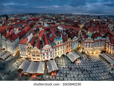 Aerial cityscape of Praguge with colorful buildings on Old Town Square (Staromestske namesti) at dusk, Czechia