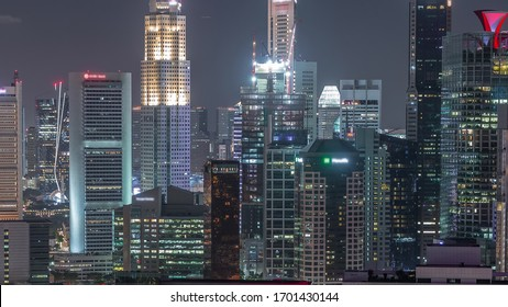 Aerial cityscape of Singapore downtown of modern architecture with illuminated skyscrapers night view, view from above from skybridge viewpoint with glowing windows in towers