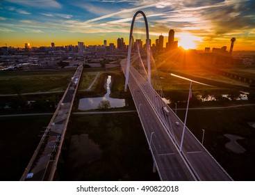 Aerial cityscape at sunrise in Dallas Texas with star burst over landmark bridge with Dtown skyline in the background with colorful morning sunshine