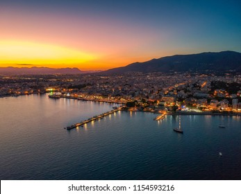 Aerial cityscape view of the Beautiful coastal city of Kalamata and the port at night. Kalamata is the capital and the second largest city in the Peloponnese, Greece, Europe.
