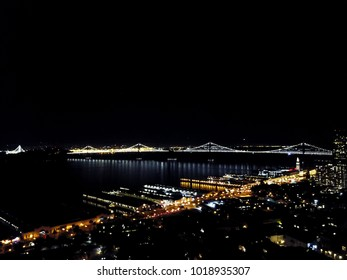 Aerial cityscape view of San Francisco at night.
