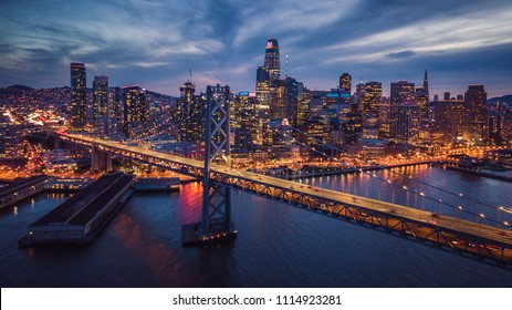 Aerial Cityscape view of San Francisco and the Bay Bridge at Night, California, USA