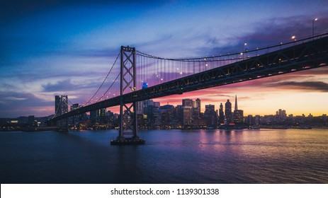 Aerial Cityscape view of San Francisco and the Bay Bridge with Colorful Sunset, California, USA