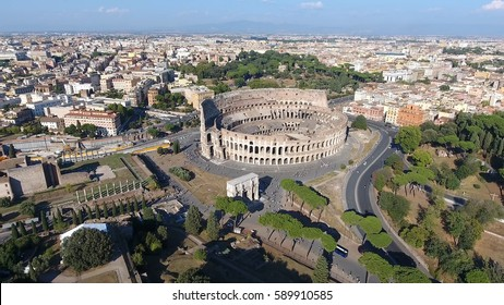 Aerial close to Colosseum also known as Coliseum or Flavian Amphitheater or Colosseo oval amphitheatre centre Rome Italy largest amphitheatre ever built popular tourist attraction in Italy summer day