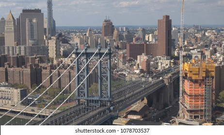 AERIAL CLOSE UP: Manhattan bridge highway connecting Brooklyn borough and downtown New York City business district. Flying above famous multiple lane expressway with cars, semi trucks driving in USA