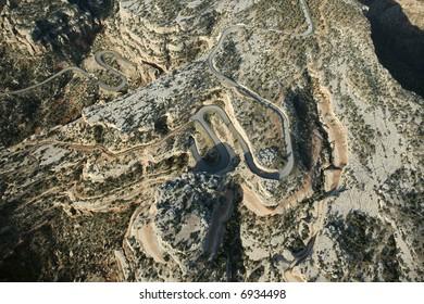 Aerial of curvy road in high desert landscape of Utah, USA.