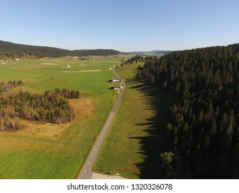 Aerial daylight drone view swiss Jura landscape with road close to La Brevine, CH Switzerland. 05th Oct. 2018