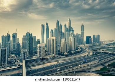 Aerial daytime skyline of Dubai Marina, UAE, with skyscrapers in the distance. Scenic travel background.