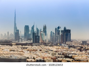 Aerial daytime skyline of Dubai, UAE, with skyscrapers in the distance. Scenic travel background.