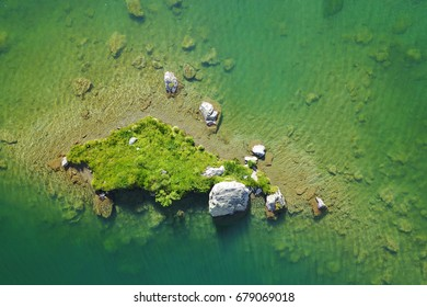 Aerial details of a small island on a alpine lake - Lake Louvie, Switzerland