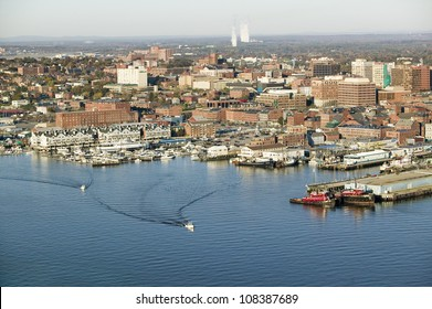 Aerial of downtown Portland Harbor and Portland Maine with view of Maine Medical Center, Commercial street, Old Port and Back Bay.