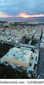 Aerial dramatic photo of famous Greek Parliament as seen on a heavy cloudy evening at dusk with beautiful colours