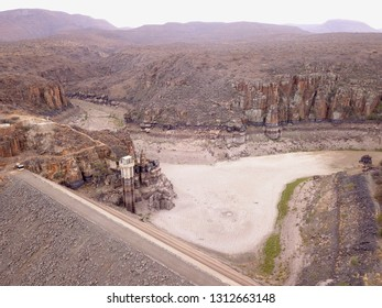 aerial of a dried up dam