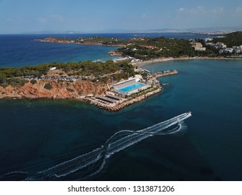 Aerial drone bird's eye panoramic photo of famous celebrity sandy beach of Astir or Asteras in south Athens riviera with turquoise clear waters, Vouliagmeni, Greece
