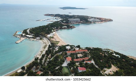 Aerial drone bird's eye photo of famous celebrity sandy beach of Astir or Asteras and Vouliagmeni beach in south Athens riviera with turquoise clear waters, Vouliagmeni, Greece