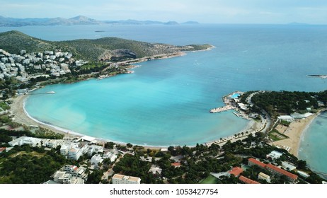 Aerial drone bird's eye photo of famous sandy beach of Vouliagmeni in south Athens riviera with turquoise clear waters, Greece