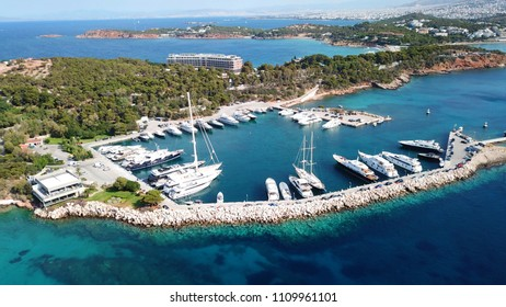 Aerial drone bird's eye photo of famous marina of Vouliagmeni with luxury yachts docked in south Athens riviera Peninsula with turquoise clear waters, Greece