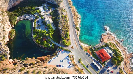 Aerial drone, bird's eye photo from iconic lake Vouliagmeni famous for healing abilities, Athens riviera, Attica, Greece