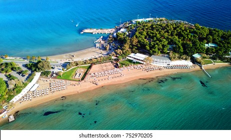 Aerial drone bird's eye photo of famous celebrity sandy beach of Astir or Asteras in south Athens riviera with turquoise clear waters, Vouliagmeni, Greece