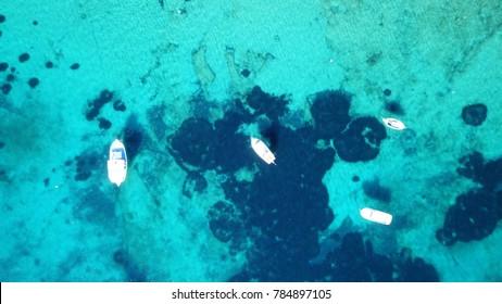 Aerial drone bird's eye photo of traditional fishing boat in island of Mykonos, Cyclades, Greece