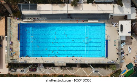 Aerial drone bird's eye view photo of tropical coastal swimming pool as seen from above