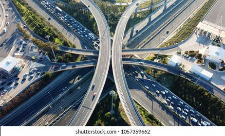 Aerial drone bird's eye view photo of latest technology cross shape multi level road highway passing through city center