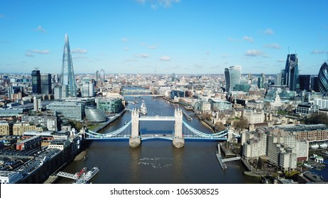 Aerial drone bird's eye view of iconic Tower Bridge, the Shard and skyline in City of London, United Kingdom