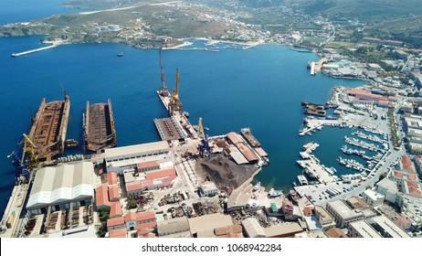 Aerial drone bird's eye view of shipyard in port of Ermoupoli, Syros island, Cyclades ,Greece