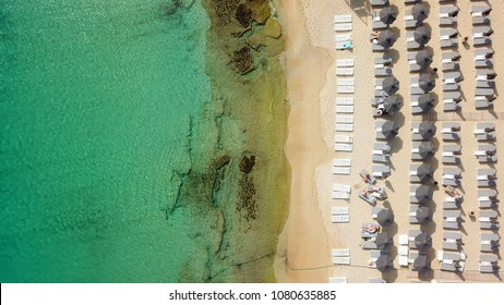 Aerial drone, bird's eye view photo of famous beach of Platy Gialos, Mykonos, Cyclades, Greece
