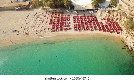 Aerial drone, bird's eye view photo of iconic and famous beach of Super Paradise with sapphire clear waters, Mykonos island, Cyclades, Greece